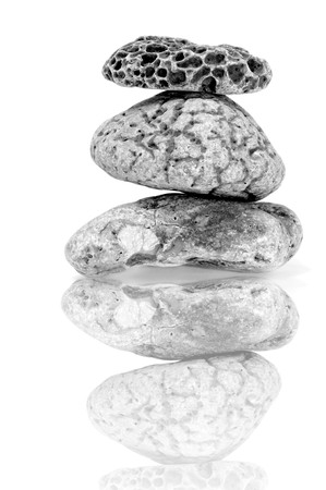 a pile of zen stones on a white background Stock Photo - 7221922