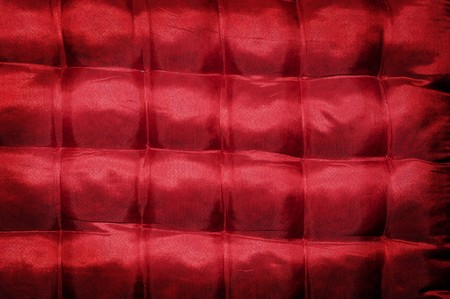 cushioned: closeup of a red satin cushioned textile Stock Photo
