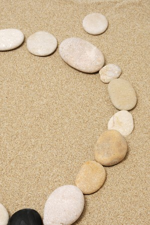 closeup of a circle made with stones on the sand Stock Photo - 7242387
