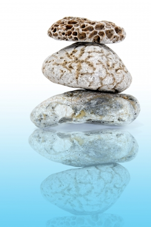 karesansui: a pile of zen stones on a white background reflected