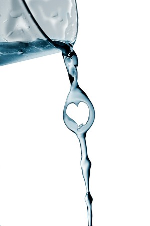 pouring water: splash water out of a glass forming a heart