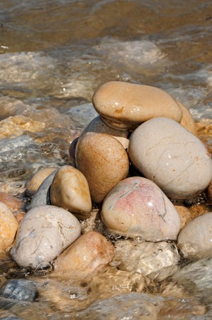 a pile of zen stones on a seashore in the summer photo