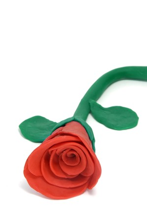 a plasticine red rose isolated on a white background photo