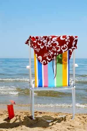 deckchair, swim suit, and cocktail on the beach Stock Photo - 7306367