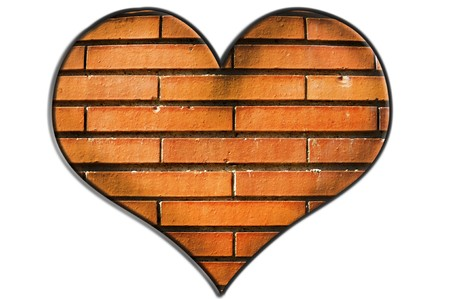 a heart with bricks texture isolated on a white background Stock Photo - 7306342