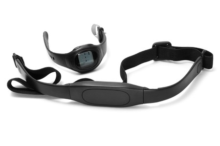 watch and chest strap of a heart rate monitor on a white background photo