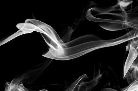 humo: colored smoke isolated on a black background