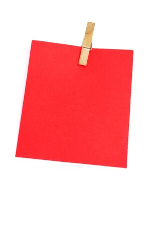 a red notebook leaf with a clothespin isolated on a white background photo