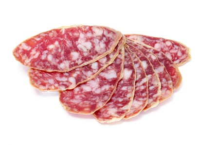 embutido: a pile of salchichon, red spanish salami, on a white background