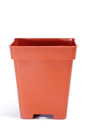 a plastic flowerpot isolated on a white background photo