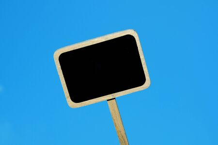 broaching: a blank blackboard label isolated on a blue background Stock Photo