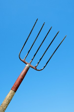 a rural pitchfork over the blue sky photo