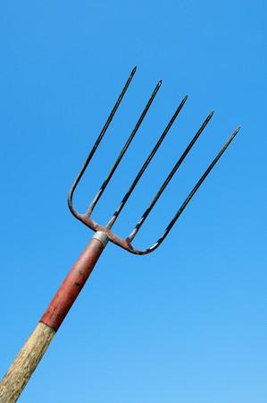 pitchfork: a rural pitchfork over the blue sky