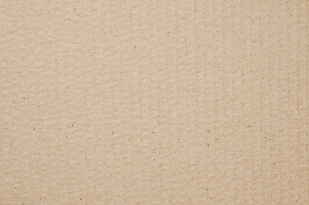 corrugated cardboard: background made of a closeup of brown cardboard Stock Photo