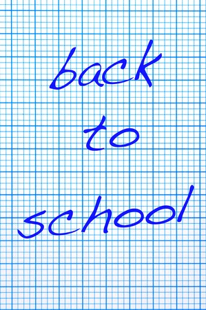 back to school written in a checkered paper sheet photo