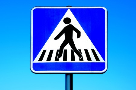 pedestrian crossing sign over the blue sky Stock Photo - 7464909