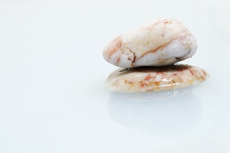a pile of zen stones on a water background Stock Photo - 7464884