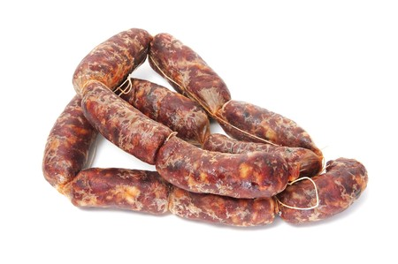 red spanish chorizos on a white background photo