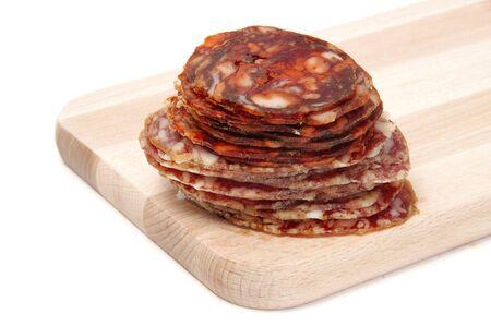 chorizos: spanish chorizo and salami  on a cutting board