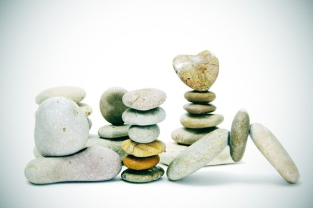 vignetting: zen stones, one heart shapped, on a white background with vignetting