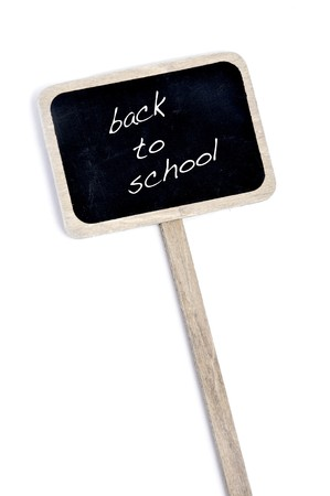 broaching: sentence back to school written in a blackboard label isolated on a white background