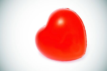 vignetted: a red heart isolated on a white background vignetted Stock Photo