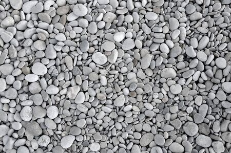 background made of a closeup of a pile of pebbles photo