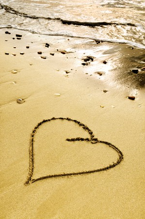 a heart drawn on the sand of a beach photo