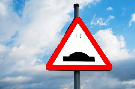 a speed bump sign in a road over the sky Stock Photo - 7600829