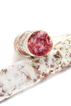 embutido: spanish salami  isolated on a white background