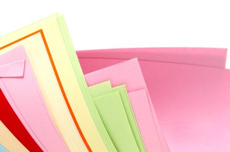 a lot of paper sheets of different colors on a white background photo