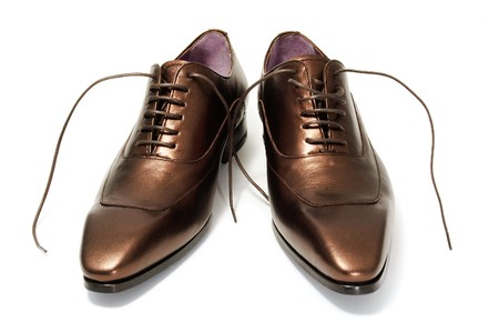 shoe strings: a pair of patent leather shoes for man isolated on a white background