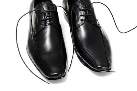 a pair of black leather shoes for man isolated photo