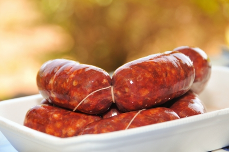 chorizos: a plate with string of chorizos typical of Spain Stock Photo
