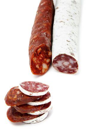 chorizos: spanish chorizo and salami  on a white background