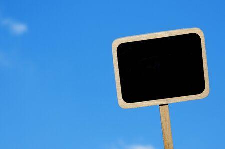 broaching: a blank blackboard label over the blue sky