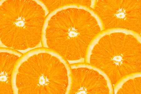 oranges: background made of a close-up of orange slices Stock Photo