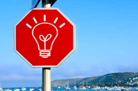 a light bulb drawn in a traffic sign symbolizing concept idea Stock Photo - 7724643
