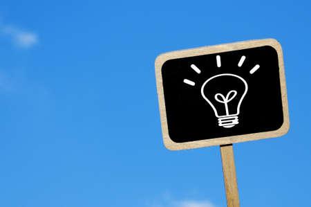 a light bulb drawn in blackboard label symbolizing de concept idea Stock Photo - 7724647