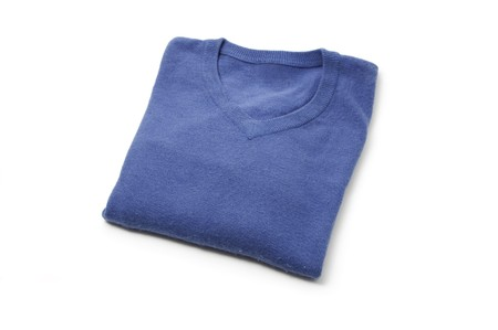 a blue wool sweater isolated on a white background photo