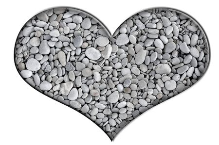 a pebbles heart isolated on a white background photo