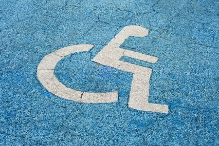 Disabled parking permit sign painted on the street Stock Photo - 7820696