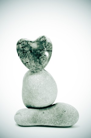 zen stones, one heart shapped, on a white background Stock Photo - 7820703