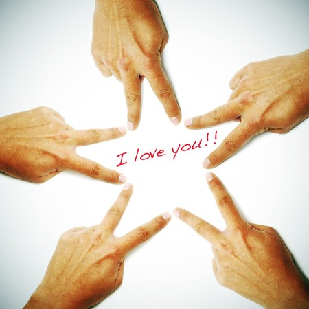 i love you written on a vignetting white background with hands drawing a star Stock Photo - 7826229
