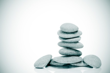 karesansui: a pile of zen stones on a white background with vignetting