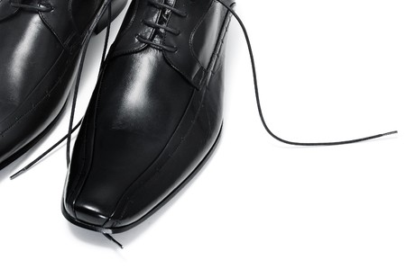 dress shoe: a pair of black leather shoes for man isolated