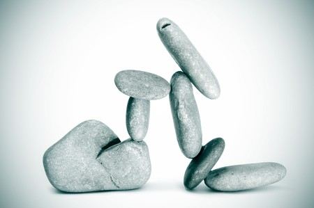 inukshuk: a pile of zen stones on a vignetting white background