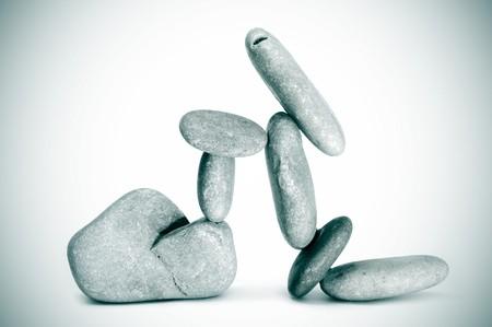 karesansui: a pile of zen stones on a vignetting white background