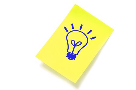 conceptual bulb: a light bulb drawn in a sticky note symbolizing concept idea