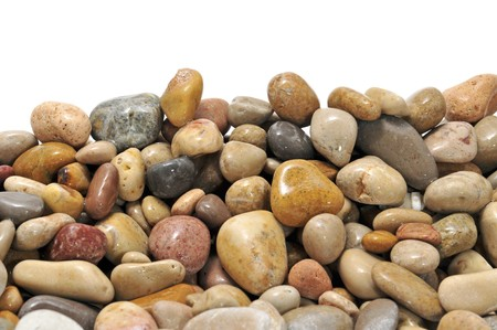 a pile of pebbles isolated on a white background photo